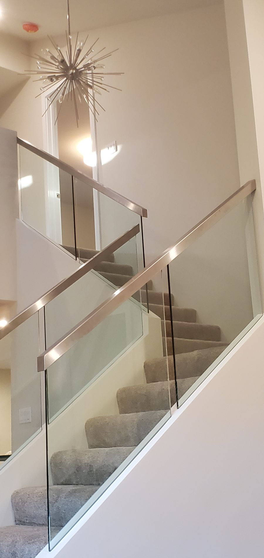 metal and glass stairwell bannister
