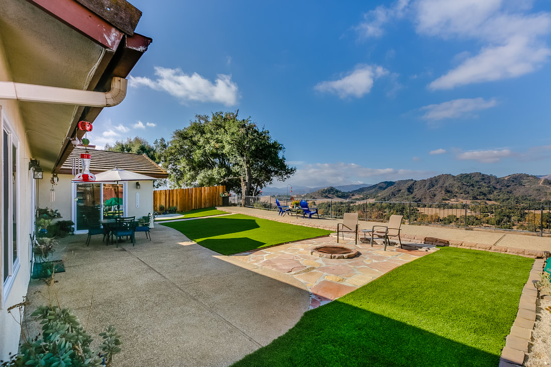 backyard of oak view home with views